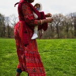 Happy Mama Babywearing with Red Ergobaby Carrier