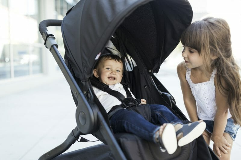A baby sits in a reversible stroller