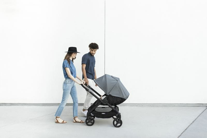 mom and dad pushing baby in stroller