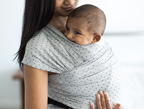 mom wearing baby in the Ergobaby Aura Baby Wrap