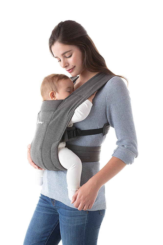 Mom using Embrace Baby Front Carry