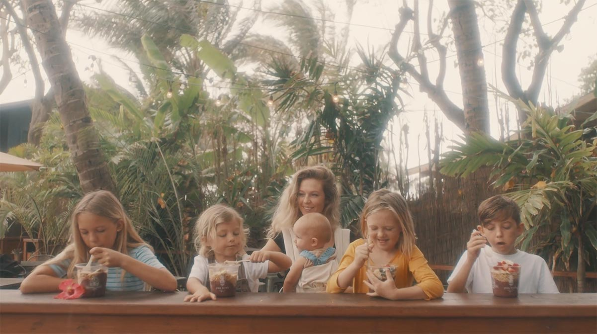 Mom with 5 kids at Acai bowl shop video